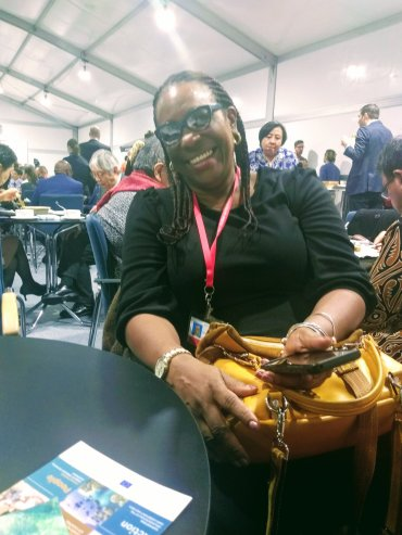 The tireless (but tired) Principal Director of Jamaica's Climate Change Division Una May Gordon still manages a smile on Gender Day, December 11. (Photo: Twitter)