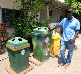 Social entrepreneur Scheed Cole with his beautiful recycle bins...made out of recycled material! (My photo)